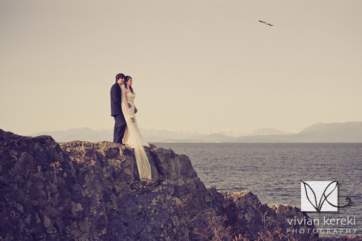 bride and groom on cliff by ocean Pipers Lagoon Nanaimo